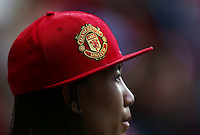 A Manchester United fan wearing a baseball style cap during the Barclays Premier League match between Manchester United and Swansea City played at Old Trafford, Manchester on January 2nd 2016