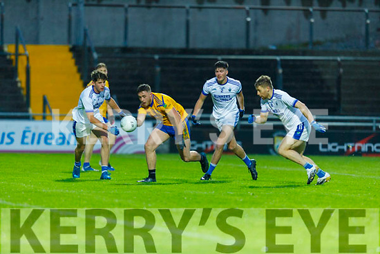 Spa's David Spillane on the attack as Laune Rangers Seán<br /> Arthurs, David Mangan and Peter Crowley attempt to close him down,  in the Intermediate Football Championship Quarter final.