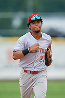 Greeneville Reds right fielder Reniel Ozuna (27) jogs back to the dugout during the first game of a doubleheader against the Princeton Rays on July 25, 2018 at Hunnicutt Field in Princeton, West Virginia.  Princeton defeated Greeneville 6-4.  (Mike Janes/Four Seam Images)