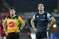 (L-R) Referee Ben Whitehouse and George North of the Ospreys check the TMO on the stadium screen during the Guinness Pro14 Round 11 match between the Ospreys and the Scarlets at the Liberty Stadium, Swansea, Wales, UK. Saturday 22 December 2018