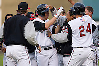 Todd Frazier #30 of the Carolina Mudcats is mobbed by his teammates after his game winning single in the bottom of the 7th inning at Five County Stadium May 18, 2009 in Zebulon, North Carolina. (Photo by Brian Westerholt / Four Seam Images)