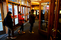 NEW YORK, NEW YORK - MARCH 05: People enter to AMC Cinema in Times Square on March 05, 2021, in New York. NY Governor, Andrew Cuomo gave the permission to reopen cinemas on Feb. 22 at 25% capacity, or a maximum of 50 people per show. (Photo by John Smith/VIEWpress)