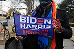 A supporter holds a Biden/Harris flag during the 59th inaugural ceremony for President Joe Biden and Vice President Kamala Harris on Wednesday, January 20, 2021 in Washington D.C.. Biden succeeds President Donald Trump to serve as the 46th President of the U.S., as Harris becomes the first female Vice President.  Photograph by Michael Nagle
