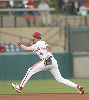 Arkansas shortstop Jalen Battles misplays a ball hit through the infield Thursday, April 1, 2021, during the fourth inning of play against Auburn at Baum-Walker Stadium in Fayetteville. Visit nwaonline.com/210402Daily/ for today's photo gallery. <br /> (NWA Democrat-Gazette/Andy Shupe)