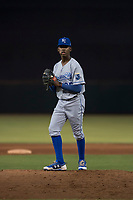 AZL Royals relief pitcher Adrian Alcantara (25) prepares to deliver a pitch during an Arizona League game against the AZL Giants Black at Scottsdale Stadium on August 7, 2018 in Scottsdale, Arizona. The AZL Giants Black defeated the AZL Royals by a score of 2-1. (Zachary Lucy/Four Seam Images)
