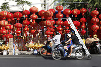 Preparation of Tet festivities 2020 in Vietnam.<br /> <br /> Tet mark the new lunar year : <br /> people buy flowers and small trees, dress up in traditional Ao Dai dress for photos.