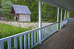 Great Smoky Mts. National Park, TN/NC<br /> Long porch of the Gregg-cable house at theJohn Cable farm in Cades Cove - smoke house in the distance