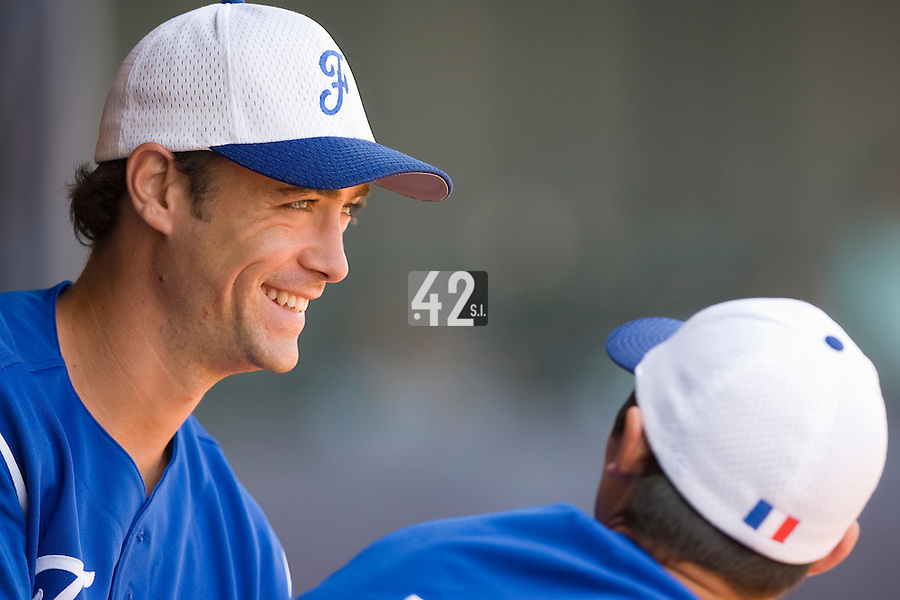 23 August 2007: #25 Jerome Rousseau is seen smiling during the France 8-4 victory over Czech Republic in the Good Luck Beijing International baseball tournament (olympic test event) at the Wukesong Baseball Field in Beijing, China.