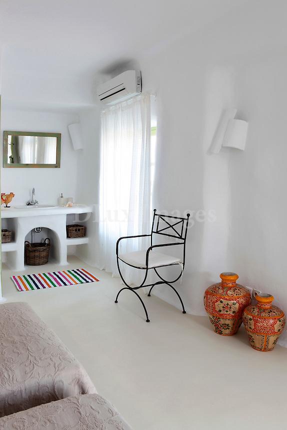 traditional cycladic bedroom with bathroom sink