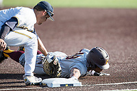 Central Michigan Chippewas outfielder Daniel Robinson (19) dives back to first base as Michigan Wolverines first baseman Jake Bivens (18) applies a tag during the NCAA baseball game on May 9, 2017 at Ray Fisher Stadium in Ann Arbor, Michigan. Michigan defeated Central Michigan 4-2. (Andrew Woolley/Four Seam Images)