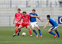 8th November 2020; SkyEx Community Stadium, London, England; Football Association Cup, Hayes and Yeading United versus Carlisle United; Jake Sheppard of Hayes & Yeading United is challenged by Gavin Reilly and Dean Furman of Carlisle United