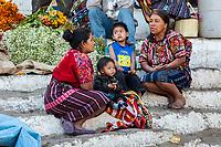 Chichicastenango, Guatemala.  Quiche (Kiche, K'iche') Women Talking on Steps of Santo Thomas Church, Sunday Morning.