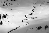 Skinning along the headwater streams back to camp