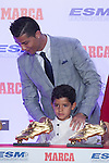 Real Madrid´s Cristiano Ronaldo poses with his son in front of the the 2014-15 Golden Boot award in Madrid, Spain. October 13, 2015. (ALTERPHOTOS/Victor Blanco)