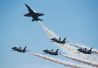 """121014-N-DR144-988 SAN DIEGO (October 14, 2012)- F/A-18C Hornets assigned to the U.S. Navy flight demonstration squadron, the Blue Angels, perform during the Marine Corps Air Station Miramar 2012 Air Show. The air show, held October 12-14, was themed """"Marines In Flight: Celebrating 50 Years of Space Exploration."""" (U.S. Navy photo by Mass Communication Specialist 1st Class James R. Evans / RELEASED)"""
