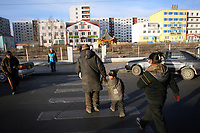 MONGOLIA. Ulaan Baatar. Battur (left),55, and his grandson Huyga (left),6, walk the streets looking for bottles that they can sell to recycling centres. The family's day revolves around a cycle of walking the streets, collecting bottles, drinking vodka, finding any food they can and just making it through the day.As the global financial crisis grips Asia, Mongolia is feeling the implications first hand as the country suffers from rising inflation pushing the price of food and fuel ever upwards. For the country's homeless, who live in sewers and abandoned garages in the capital and already face extreme discrimination and are denied access to basic health and social care, their lives are hanging in the balance. 2008