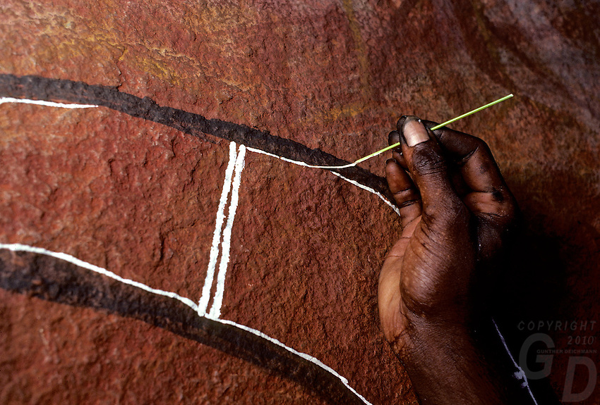 ABORIGINAL PAINTING INSIDE A CAVE,IN ARNHEM LAND NORTHERN TERRITORY<br /> THE TRADITIONAL WAY OF RETOUCHING ROCK ART, AUSTRALIA