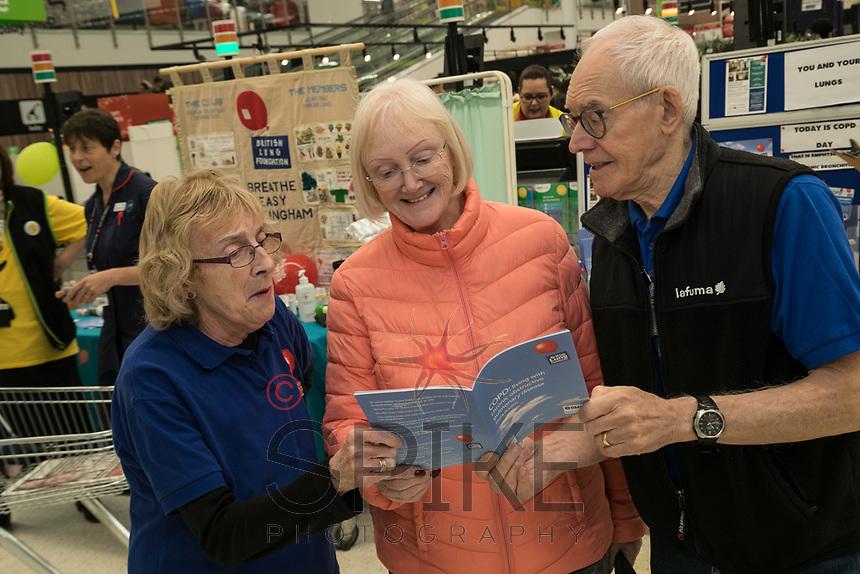 Asda customer Sandra Speyers of Edwalton (centre) meets Barbara Preston and Malcom Ginever of the Breathe Easy group