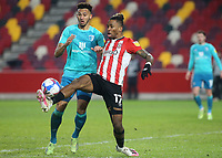 Brentford's Ivan Toney controls the ball under pressure from AFC Bournemouth's Lloyd Kelly during Brentford vs AFC Bournemouth, Sky Bet EFL Championship Football at the Brentford Community Stadium on 30th December 2020