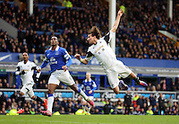 Pictured: Michu of Swansea jumps for a header. Saturday 22 March 2014<br /> Re: Barclay's Premier League, Everton v Swansea City FC at Goodison Park, Liverpool, UK.