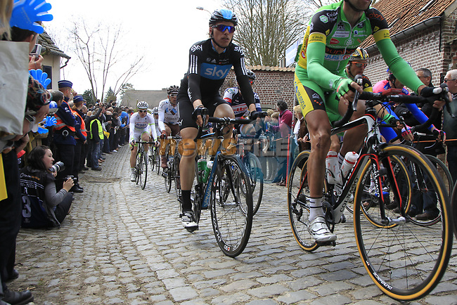 The peloton including Christian Knees (GER) Sky Procycling climbs Molenberg during the 96th edition of The Tour of Flanders 2012, running 256.9km from Bruges to Oudenaarde, Belgium. 1st April 2012. <br /> (Photo by Eoin Clarke/NEWSFILE).