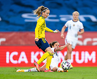 SOLNA, SWEDEN - APRIL 10: Kosovare Asllani #9 of Sweden is tackled by Carli Lloyd #10 of the USWNT during a game between Sweden and USWNT at Friends Arena on April 10, 2021 in Solna, Sweden.