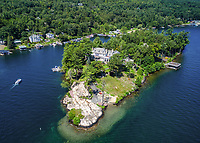 BNPS.co.uk (01202 558833)<br /> Pic: Sotheby'sInternational Realty/BNPS<br /> <br /> A stunning private island nestled on one of America's most scenic lakes has emerged on to the market for £11.5million. ($15m)<br /> <br /> 114 Green Harbor Lane sits on its own 3.3 acres peninsula in the middle of Lake George in the northern part of the state of New York.<br /> <br /> The centrepiece of the island is an impressive 15 bedroom mansion, while there is also a boathouse, two cottages and a private sandy beach.<br /> <br /> It has 2,700ft of lakefront - with room for 36 dock spaces - and spectacular mountain views.<br /> <br /> The island is being sold with estate agent Sotheby's International Realty, who describe its purchase as a 'once in a lifetime opportunity'.