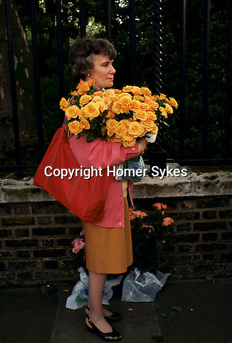 Chelsea Flowers Show last day taking home flowers sold cheaply at the end of the show London Uk 1984