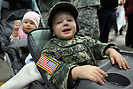 Alexander Breuer, 21 months, and his sister Allyssa, 10 months wait for their dad Staff Sgt. Christopher Breuer and the 422nd Expeditionary Signal Battalion of the Nevada National Guard who returned home Sunday, Jan. 15, 2012, after a yearlong deployment to Afghanistan. Hundreds of family and friends greeted the soldiers at the Nevada Air Guard Base in Reno, Nev..Photo by Cathleen Allison
