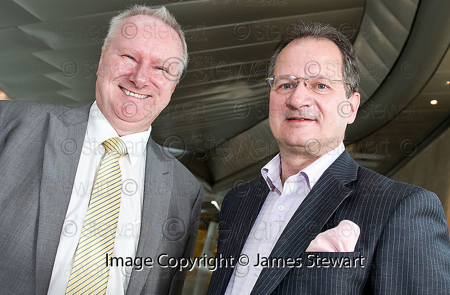 Cabinet Secretary for Infrastructure and Capital Investment, Alex Neil MSP (left),  with Graeme Ross, Business Development Director, BMI Regional, at the announcement of the sale of BMI Regional's sale from IAG to Sector Aviation  Holdings (SAH) .............31/05/2012    jsp008_bmi   .Copyright  Pic : James Stewart.James Stewart Photography 19 Carronlea Drive, Falkirk. FK2 8DN      Vat Reg No. 607 6932 25.Telephone      : +44 (0)1324 570291 .Mobile              : +44 (0)7721 416997.E-mail  :  jim@jspa.co.uk.If you require further information then contact Jim Stewart on any of the numbers above........