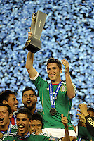 Mexico captain Hiram Mier holds the CONCACAF trophy... Mexico defeated Honduras 2-1 after extra time to win the CONCACAF Olympic qualifying trophy at LIVESTRONG Sporting Park, Kansas City, Kansas.
