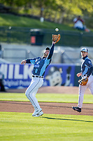 West Michigan Whitecaps third baseman Spencer Torkelson (8) catches a pop ball against the Great Lakes Loons at LMCU Ballpark on May 11, 2021 in Comstock Park, Michigan. The Loons defeated the Whitecaps in their home opener 9-1. (Andrew Woolley/Four Seam Images)