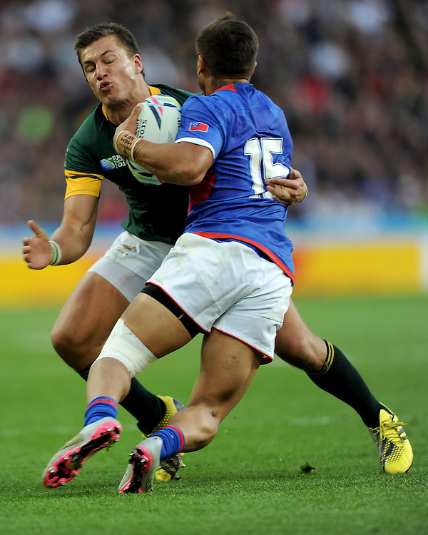 Handre Pollard of South Africa wraps up Tim Nanai-Williams of Samoa during Match 15 of the Rugby World Cup 2015 between South Africa and Samoa - 26/09/2015 - Villa Park, Birmingham<br /> Mandatory Credit: Rob Munro/Stewart Communications