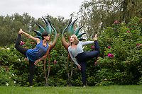 BNPS.co.uk (01202) 558833<br /> Pic: ZacharyCulpin/BNPS<br /> <br /> Life imitating art - Yoga teachers, Rachel Parker (left) and Lillie Hussain adopt similar poses to the sculptures before the start of the five-day festival, 'Wellbeing by the lakes'.<br /> <br /> The event aims to explore 'what it means to be mindful and live well in a fast-paced modern world' It is held is in the 26 acre Sculpture by the Lakes park in the heart of Dorset countryside.  <br /> <br /> There will be expert talks, guided meditations, yoga art and shopping, 'movement sessions', sound baths and healing therapies. It takes place from September 8 to September 12