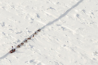 A team crosses through snow-covered jumbled Yukon River ice on the trail between Tanana and Ruby on Wednesday afternoon  March 11th during the 2015 Iditarod.<br /> <br /> (C) Jeff Schultz/SchultzPhoto.com - ALL RIGHTS RESERVED<br />  DUPLICATION  PROHIBITED  WITHOUT  PERMISSION