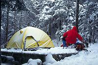Winter hiker preparing a tentsite in NH's White Mountains, at the Naumann tentsite of Mizpah Springs AMC hut. On Fujichrome Provia 100. Bill McDonald. Naumann Tentsite NH USA Near Mizpah Hut, Mt Clinton.