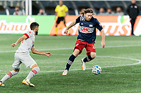 FOXBOROUGH, MA - OCTOBER 7: Tommy McNamara #26 of New England Revolution controls the ball during a game between Toronto FC and New England Revolution at Gillette Stadium on October 7, 2020 in Foxborough, Massachusetts.