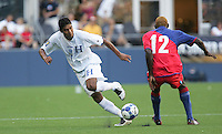 Melvin Valladares (18) dribbles the ball past James Marcelin (12). Honduras defeated Haiti 1-0 during the First Round of the 2009 CONCACAF Gold Cup at Qwest Field in Seattle, Washington on July 4, 2009.