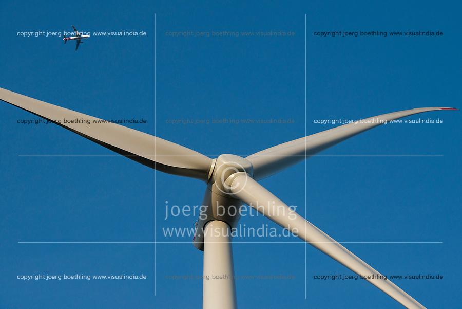 GERMANY Hamburg, Eurowings aircraft and wind turbine Siemens SWT-3.0-113 of Municipal energy supplier Hamburg Energie at Trimet company area