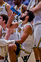 12 March 2019: University of Vermont Catamount Forward Anthony Lamb, a Junior from Toronto, Ontario, hydrates during a time out against the Binghamton University Bearcats at Patrick Gymnasium in Burlington, Vermont. Lamb finished the game with 18 points and a career-high seven assists as the top-seeded Catamounts advanced to their fourth-straight America East conference championship game, defeating the Bearcats 84-51. Mandatory Credit: Ed Wolfstein Photo *** RAW (NEF) Image File Available ***
