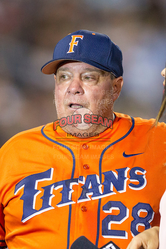 Cal State Fullerton Titans head coach Rick Vanderhook (28) during the NCAA College baseball World Series against the Vanderbilt Commodores on June 14, 2015 at TD Ameritrade Park in Omaha, Nebraska. The Titans were leading 3-0 in the bottom of the sixth inning when the game was suspended by rain. (Andrew Woolley/Four Seam Images)
