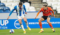 7th November 2020 The John Smiths Stadium, Huddersfield, Yorkshire, England; English Football League Championship Football, Huddersfield Town versus Luton Town; Harry Cornick of Luton Town jockeys Harry Toffolo of Huddersfield Town