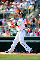 Baltimore Orioles first baseman Chris Davis #19 hits a home run during a Spring Training game against the New York Mets at Ed Smith Stadium on March 30, 2013 in Sarasota, Florida.  (Mike Janes/Four Seam Images)