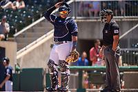 Northwest Arkansas Naturals catcher Xavier Fernandez (34) looks to the dugout between batters on May 19, 2019, at Arvest Ballpark in Springdale, Arkansas. (Jason Ivester/Four Seam Images)