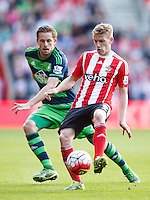 Steven Davis and Gylfi Sigurdsson during the Barclays Premier League match between Southampton v Swansea City played at St Mary's Stadium, Southampton