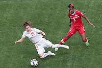 June 21, 2015: Ramona BACHMANN of Switzerland is fouled by Kadeisha BUCHANAN of Canada during a round of 16 match between Canada and Switzerland at the FIFA Women's World Cup Canada 2015 at BC Place Stadium on 21 June 2015 in Vancouver, Canada. Canada won 1-0. Sydney Low/Asteriskimages.com