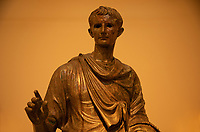 Athens archeological museum Statue of th eemperor Augustus (29 BC-AD 14) Bronze  He west a tunica (clavus purpurea) and a fringed paludamentum .On the bezel of his finger-ring is engraved a symbol of the supreme religious office of Pontifex Maximus
