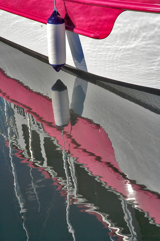 Boat reflected in harbor water. Garibaldi boat harbor. Oregon
