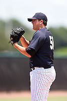 GCL Yankees 2 pitcher Jonathan Holder (56) prepares to deliver a pitch during a game against the GCL Braves on June 23, 2014 at the Yankees Minor League Complex in Tampa, Florida.  GCL Yankees 2 defeated the GCL Braves 12-4.  (Mike Janes/Four Seam Images)