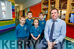 Paul Horan Principal of Holy Family NS Rathmore who is appealing for help in stopping leaks in the roof of the school pictured with pupils Ronan Casey David Casey Mia Burke and Evan Burke.